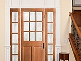 Woodgrain 9 Lite Sash and Panel Door 9 over raised 2 panels with complementary sidelights with Delta Frosted Glass 6562 and 1705
